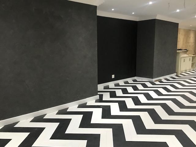 black and white herringbone flooring